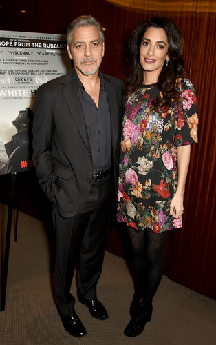 LONDON, ENGLAND - JANUARY 09:  George and Amal Clooney attend the Netflix special screening and reception of The White Helmets hosted by The Clooney Foundation For Justice with George and Amal Clooney, at the Bvlgari Hotel on January 9, 2017 in London, England.  (Photo by David M. Benett/Dave Benett/Getty Images for Netflix )