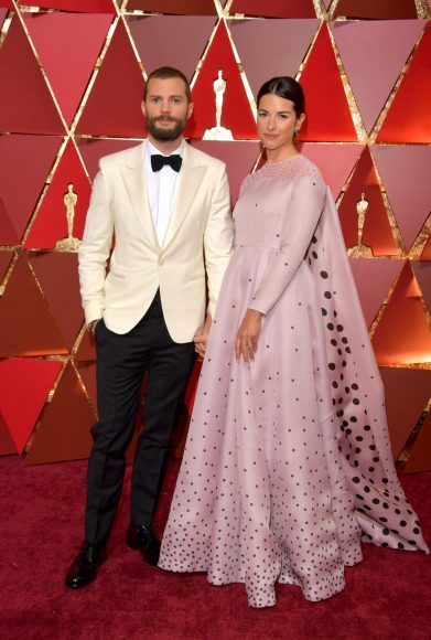 HOLLYWOOD, CA - FEBRUARY 26: Actors Jamie Dornan (L) and Amelia Warner attend the 89th Annual Academy Awards at Hollywood & Highland Center on February 26, 2017 in Hollywood, California. (Photo by Lester Cohen/WireImage)