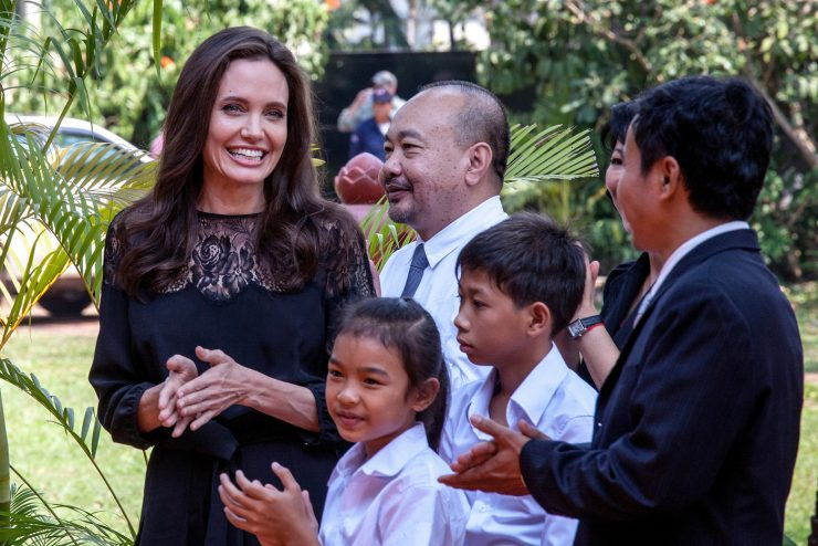 "SIEM REAP, CAMBODIA - FEBRUARY 18:  Angelina Jolie (left) and producer Rithy Panh (center) chat with actors before holding a press conference ahead of the premiere of their new film ""First They Killed My Father"" set up at the Raffles Grand Hotel D'Angkor on February 18, 2017 in Siem Reap, Cambodia. Angelina Jolie is in Siem Reap for the world premiere of her new movie, ""First They Killed my Father,"" a Netflix-produced adaption of the autobiography by the same name penned by Loung Ung, who lived through the Khmer Rouge regime as a young child. The film will be screened Saturday night in the Angkor Wat temple complex, and released later this year on Netflix. (Photo by Omar Havana/Getty Images)"